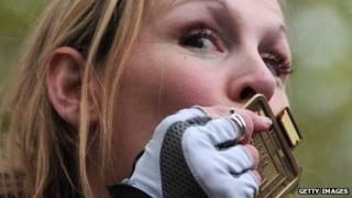 Claire Lomas kisses her medal after completing the London Marathon in 2012