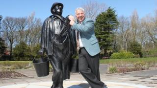 New statue of Charlie Caroli and his son Charlie junior