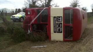Overturned double-decker bus, near Lisburn
