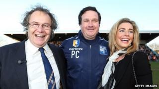 John Radford the Chairman of Mansfield Town celebrates with Manager Paul Cox and his wife Caroline Radford