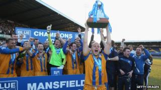 Adam Murray of Mansfield lifts the trophy