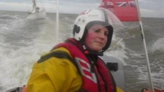 Stacey Sonley at the helm of a lifeboat