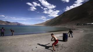 In this 22 July 2011 file photo, children play cricket near Pangong Lake, near the India-China border in Ladakh, India