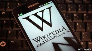 Wikipedia logo on phone