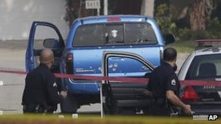 Police at the scene of an accidental police shooting of two women during a manhunt in Los Angeles, California 7 February 2013