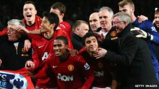 Phil Jones, Shinji Kagawa, Antonio Valencia, Rafael and manager Sir Alex Ferguson of Manchester United celebrate winning the Premier League title after the Barclays Premier League