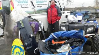 Pembrokeshire Coast National Park Authority Ranger Richard Vaughan and rubbish collected after the snow
