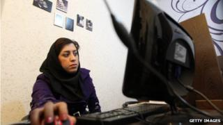 Woman surfs the internet in Tehran