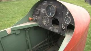 The plane's cockpit is in need of repair.