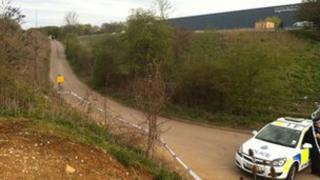 Police near entrance to Dyes Lane caravan site