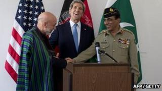 Afghan President Hamid Karzai, US Secretary of State John Kerry and Pakistani military chief General Kayani following talks in Brussels