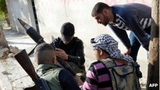 Opposition forces prepare to launch rocket attacks near the city of Aleppo