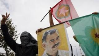 Masked demonstrators display a picture of jailed Kurdish rebel leader Abdullah Ocalan (file photo)