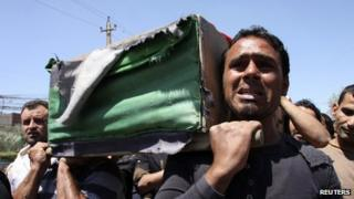 Funeral of an Iraqi soldier killed in clashes. Baghdad, 25 April 2013