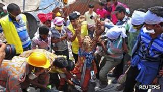 A woman is pulled out of the building on 25 April
