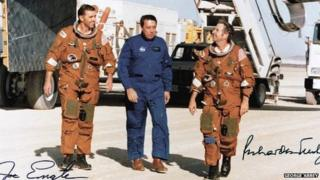 George Abbey with crew members of a space shuttle