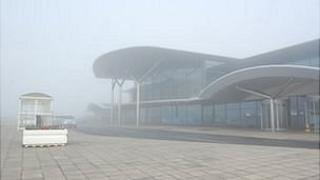 Guernsey Airport terminal in fog