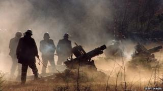 Serbian guns fire on Croatian targets during the 1991 conflict between Croatia and Serbs