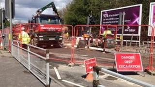 Engineers work on Great Western Way after 12-inch water pipe burst after 12-inch water pipe burst