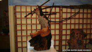 An oak tree speared by iron railings during a WWII bomb explosion