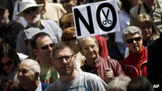 Protesters in Spain demonstrate against regional government spending cuts