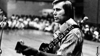 In this undated photo, country singer George Jones is shown performing with his guitar