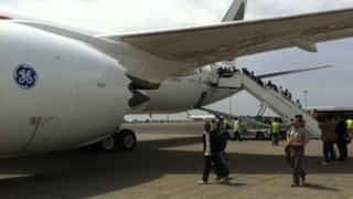 Passengers embark on the flight to Nairobi