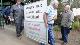 Raid members dismantle their camp after Gypsies leave the Meriden field