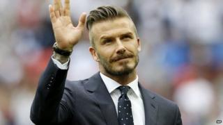 David Beckham waving to crowds