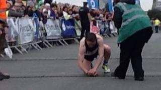 Jim Cole crossing finish line