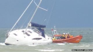 Stranded yacht and rescue lifeboat