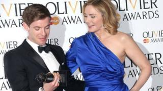 Luke Treadaway, winner of Best Actor Award for The Curious Incident of the Dog in the Night-time and Kim Cattrall in the press room at the Olivier Awards 2013