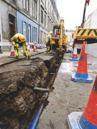 Worker replacing water mains