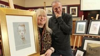 Terry and Peter Howson with some of his work which is being sold
