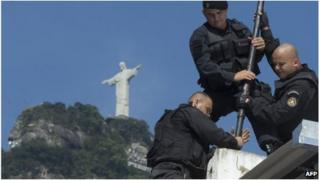 Police prepare flag pole in Rio favela