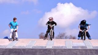 Cyclists wait on the BMX ramp