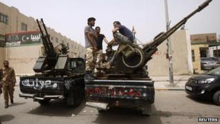 Armed men outside Libya's justice ministry in Tripoli on 30 April 2013