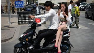 Chinese couple on a bike