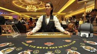 A dealer at a gambling table in Macau