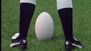 Generic shot of rugby player with ball