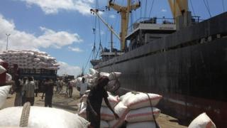 Workers load ship in Mogadishu