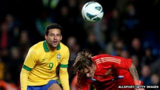 Brazilian international Fred (left)