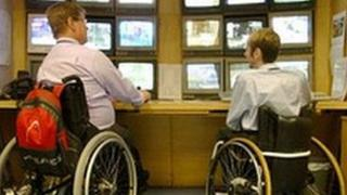 Two wheelchair users at work