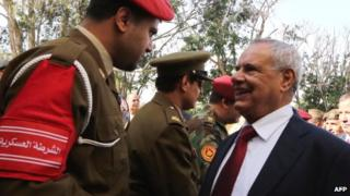 Libyan Defence Minister Mohammed al-Barghathi (R) shakes hand with a Libyan army officer - November 2012