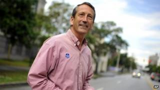 Former South Carolina Governor Mark Sanford crosses the street after voting at a polling place in Charleston, South Carolina 7 May 2013