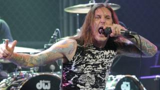 Tim Lambesis singing with his band As I Lay Dying