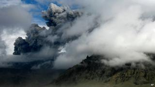A plume of ash rises from a volcano erupting under the Eyjafjallajokull glacier