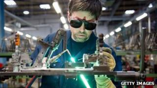 Worker in UK bicycle factory