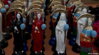 Statues of Santa Muerte are lined up for sale in Mexico City on 1 November 2012