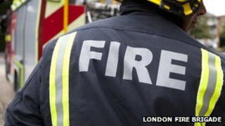 Fireman in front of fire truck